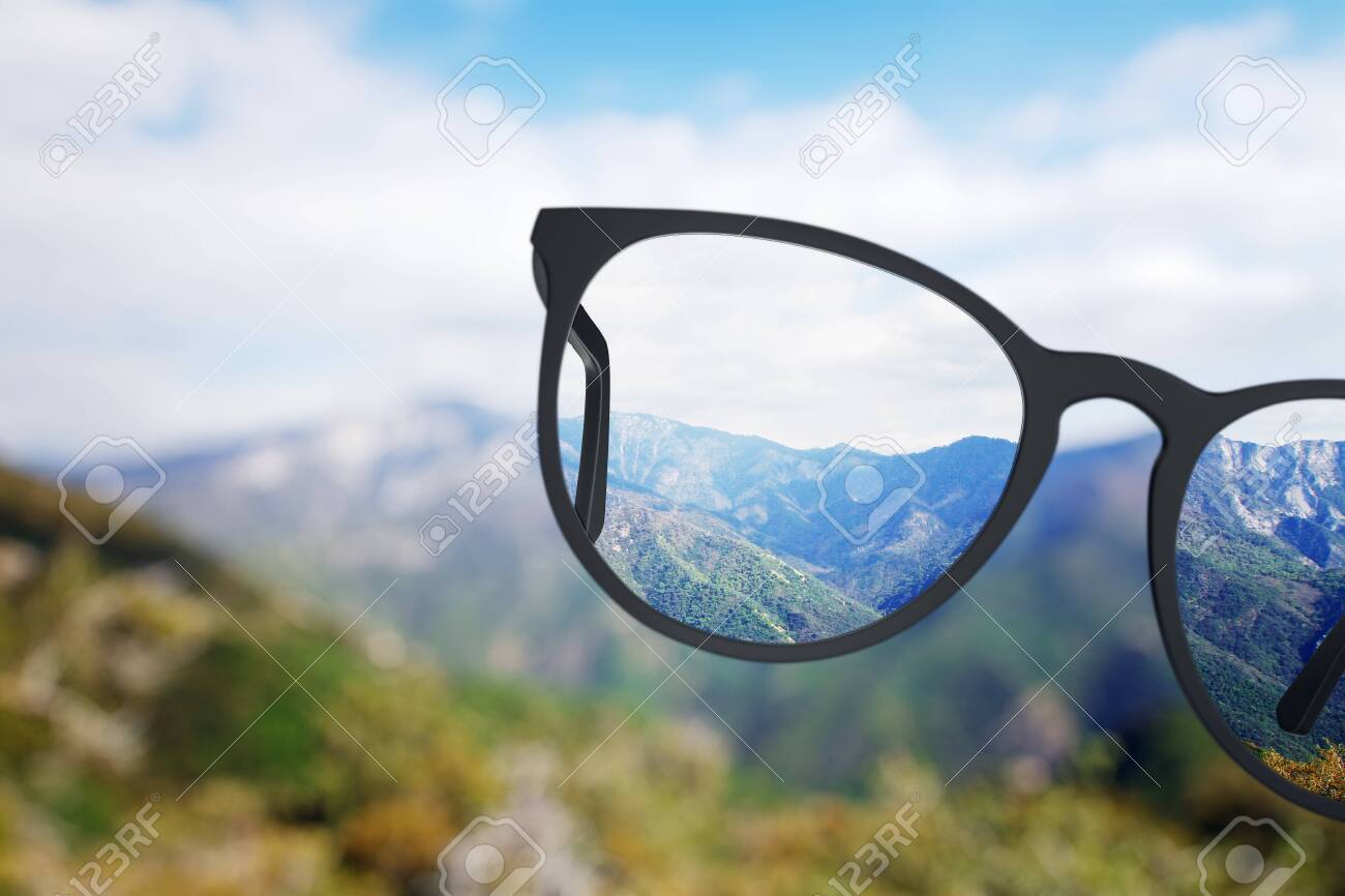 Creative nature view though eyeglasses. Blurry background. Vision concept - 128921699