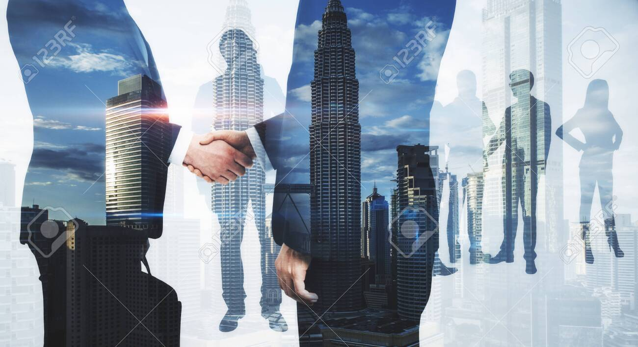 Meeting of businesspeople on abstract city background. Teamwork and success concept. Multiexposure - 133082536