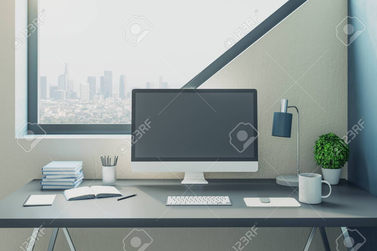 - Minimalistic Office With Computer On Table And Big Light Windows