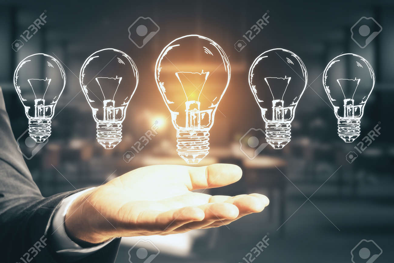 Businessman hand holding five drawing abstract light bulbs. Success and startup concept. Close up - 158657102
