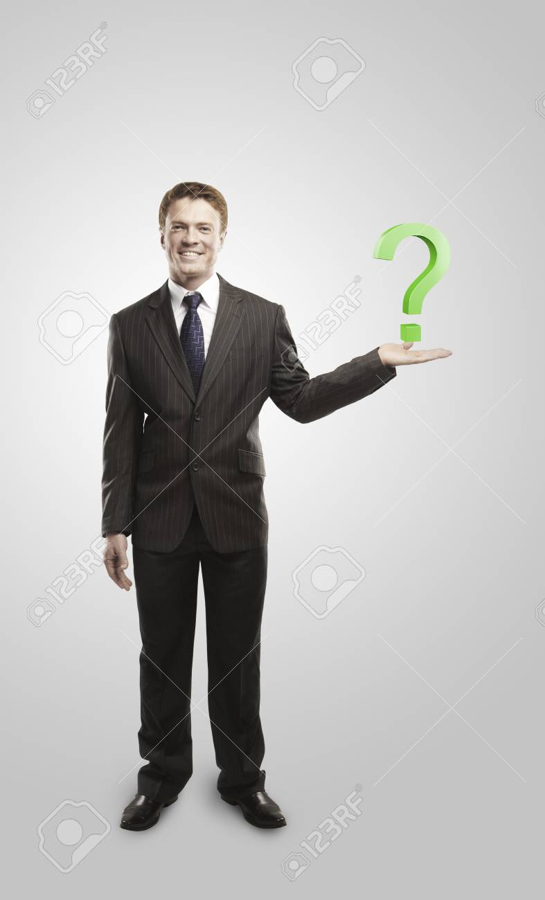Young  businessman with a question mark on his hand. On a gray background Stock Photo - 11286428