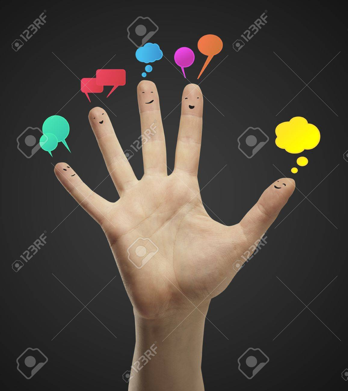 Happy group of finger smileys with social chat sign and speech bubbles. Fingers representing a social network. Stock Photo - 11788963