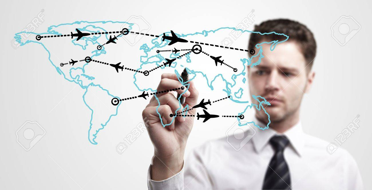 Young business man drawing an airplane routes on world map  Man drawing world map with aircraft flying on a glass window  The metaphor of international air travel around the world, travel to anywhere on the planet Earth and the workload of air traffic Stock Photo - 13110865