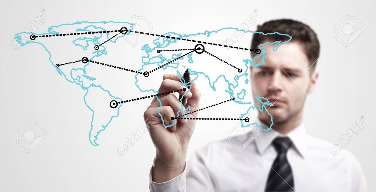 Young business man drawing a global network or globalization concept on world map   Man drawing internet diagram or business connection on a glass window  On a gray background Stock Photo - 13366202