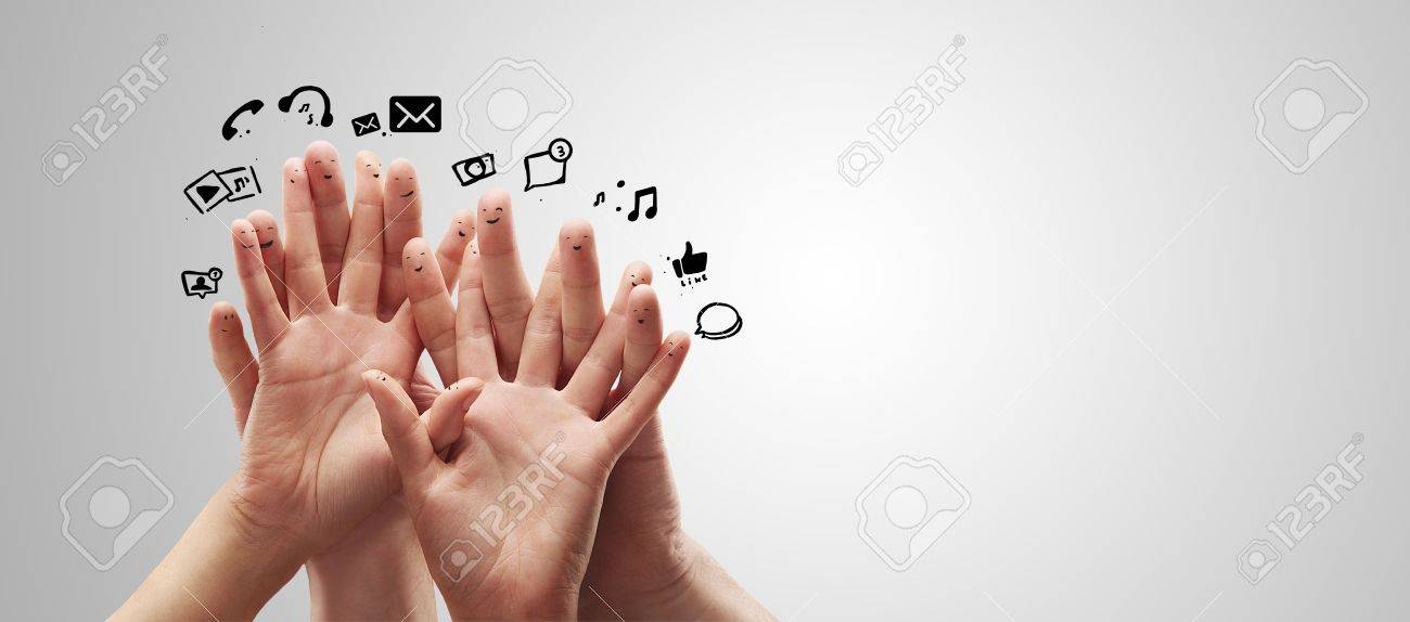 Happy group of finger smileys with social chat sign and speech bubbles,icons  Fingers representing a social network Stock Photo - 13366300