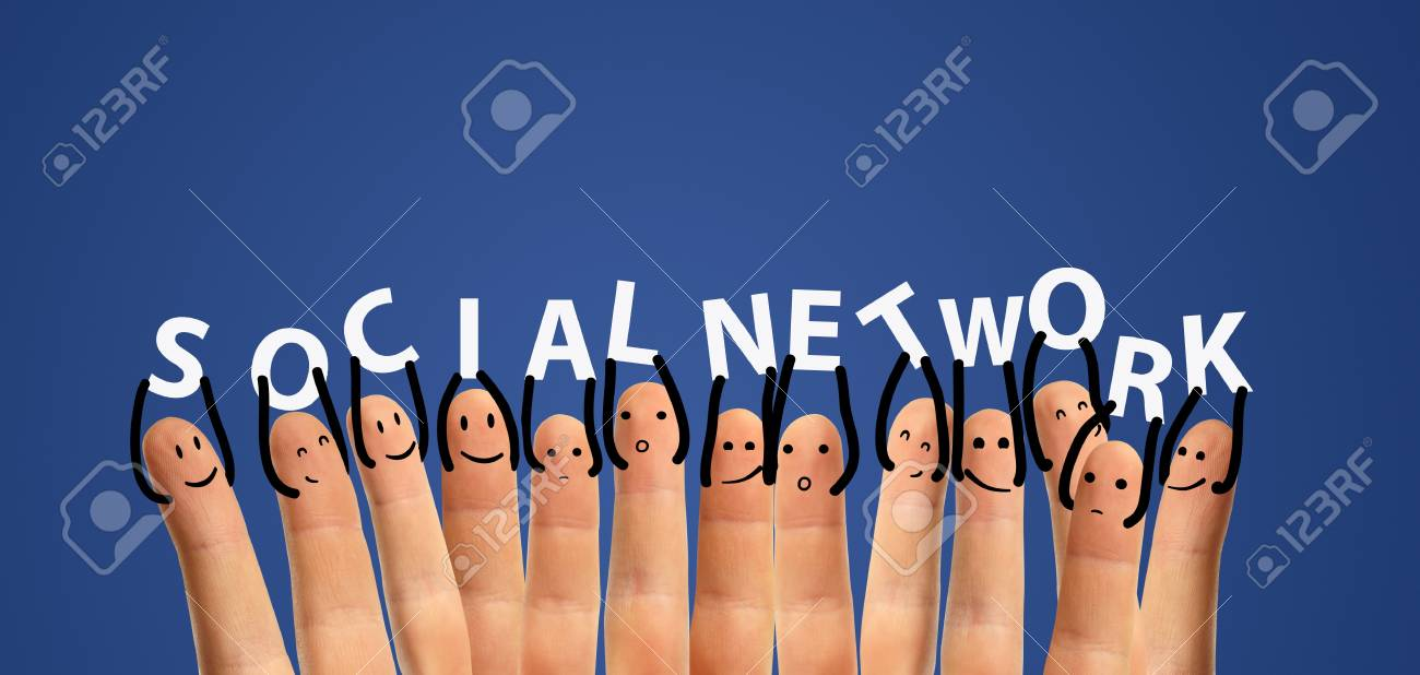 Happy group of finger smileys with social chat sign and speech bubbles, icons  Hands holding  letters   Fingers representing a social network Stock Photo - 13366299