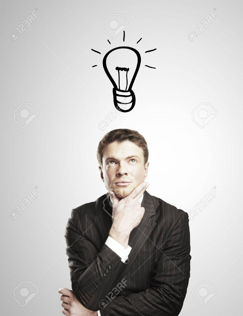 pensive man with a drawing lamps over his head Stock Photo - 14625971