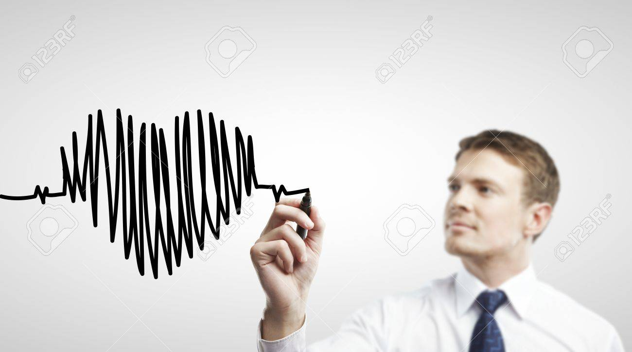 businessman drawing chart heartbeat on a white background Stock Photo - 14768692