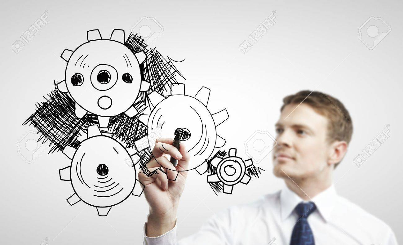 businessman drawing gears on a white background Stock Photo - 14768757