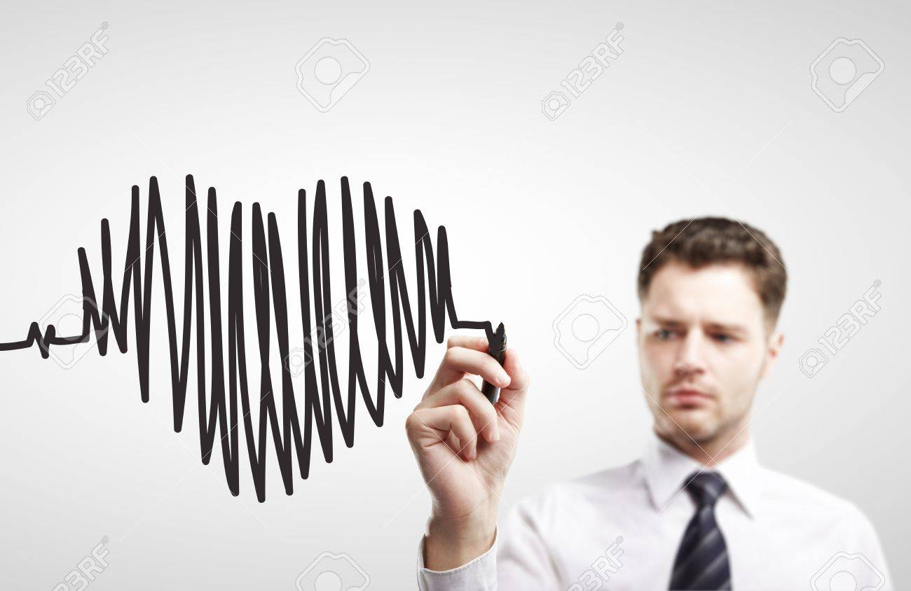 businessman drawing chart heartbeat on a white background Stock Photo - 14884378