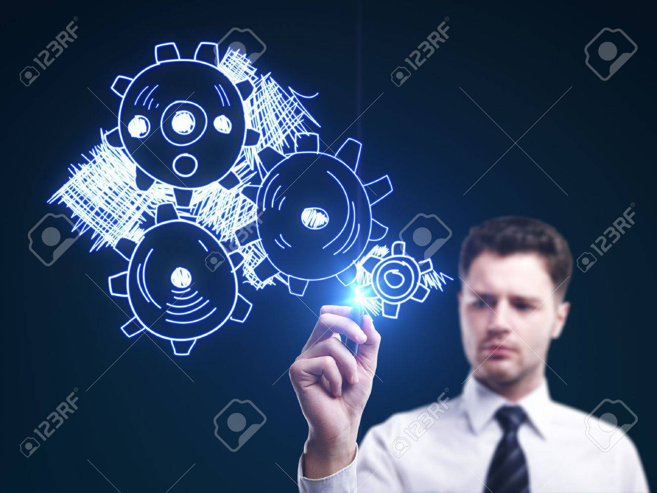 man drawing gears on a blue background Stock Photo - 15359166