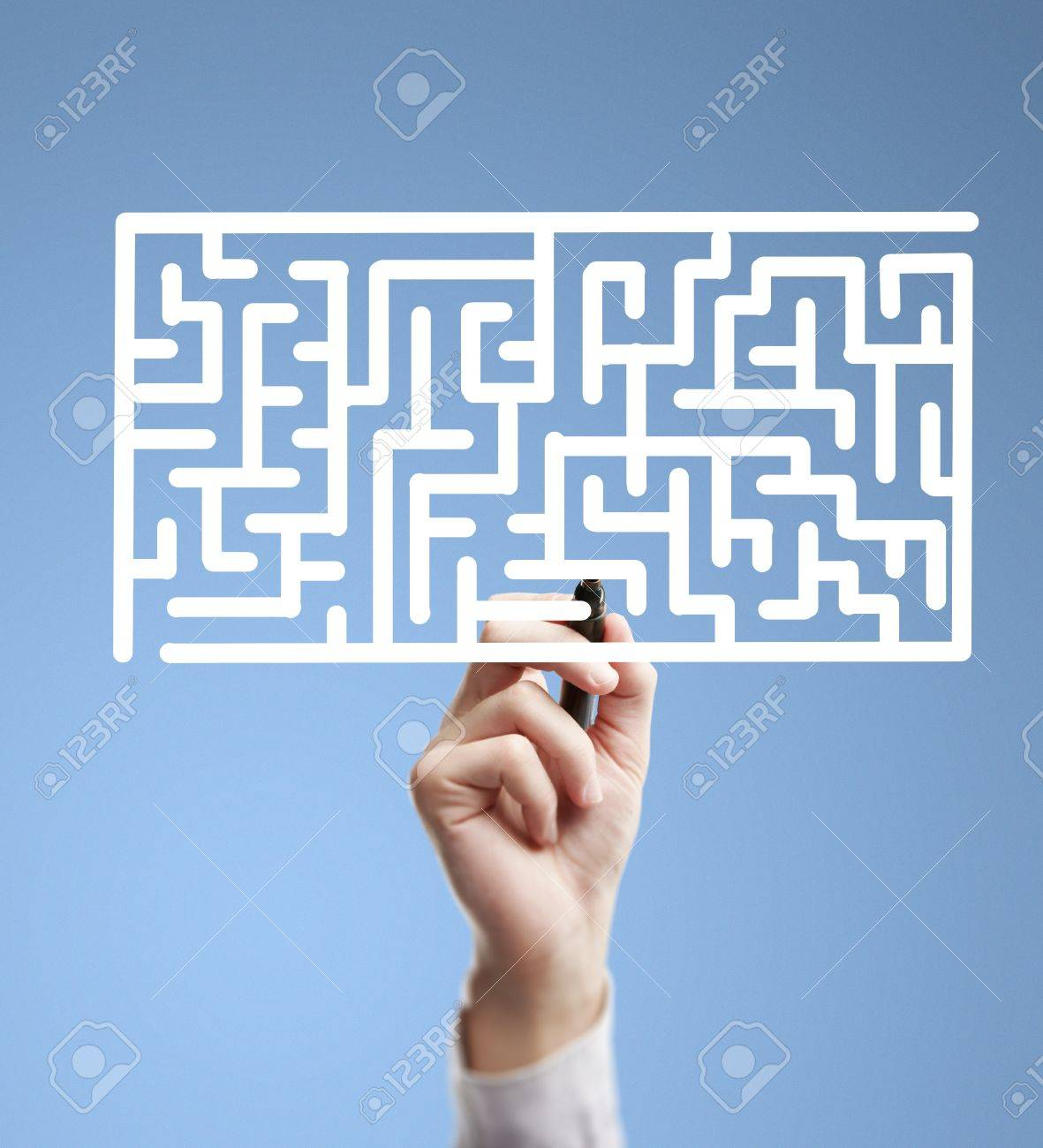 hand drawing labyrinth on a blue background Stock Photo - 15788255