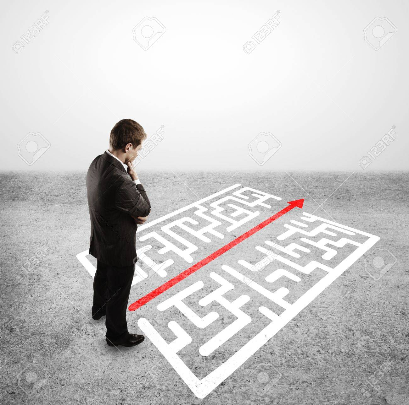 businessman in front of labyrinth with arrow Stock Photo - 16119359