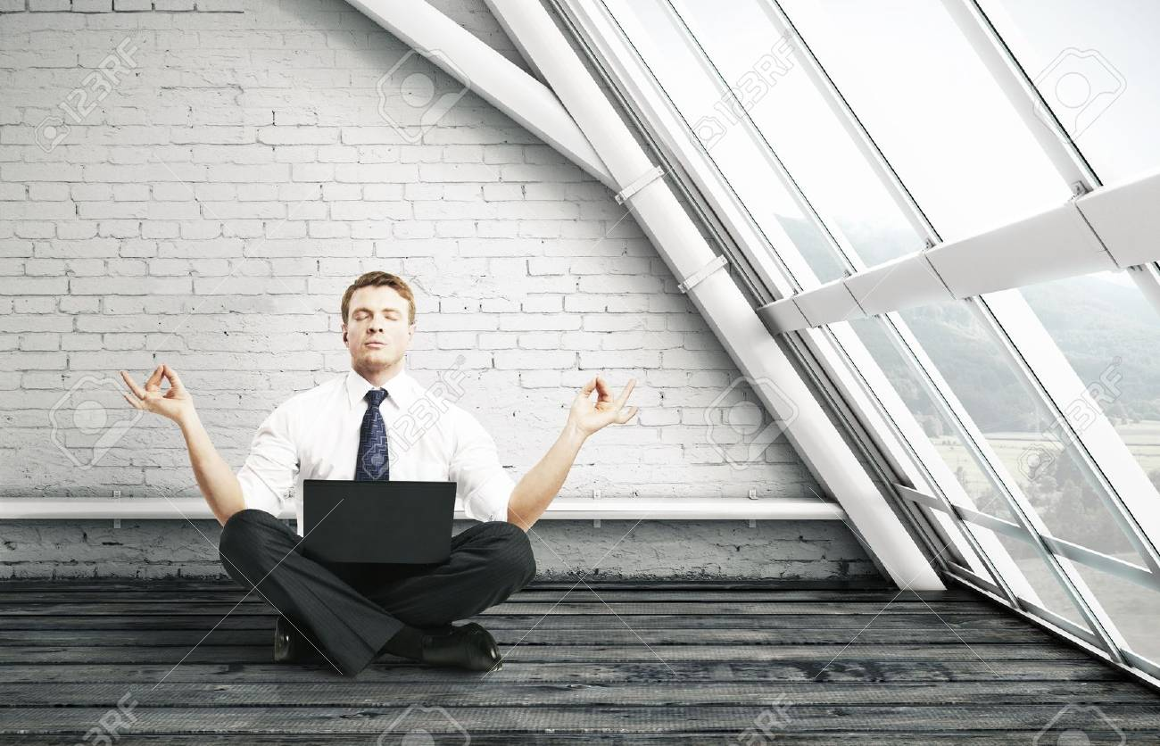 businessman meditation in brick room Stock Photo - 16249908
