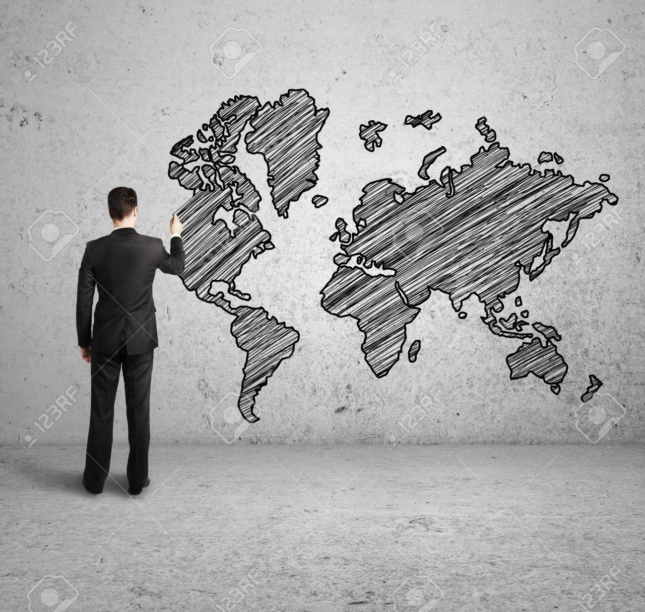 Man drawing world map on concrete wall stock photo picture and man drawing world map on concrete wall stock photo 16249916 gumiabroncs Choice Image