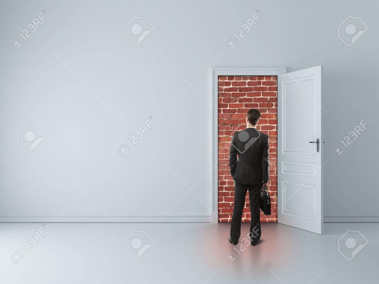 businessman in blue room with walled door Stock Photo - 16343226