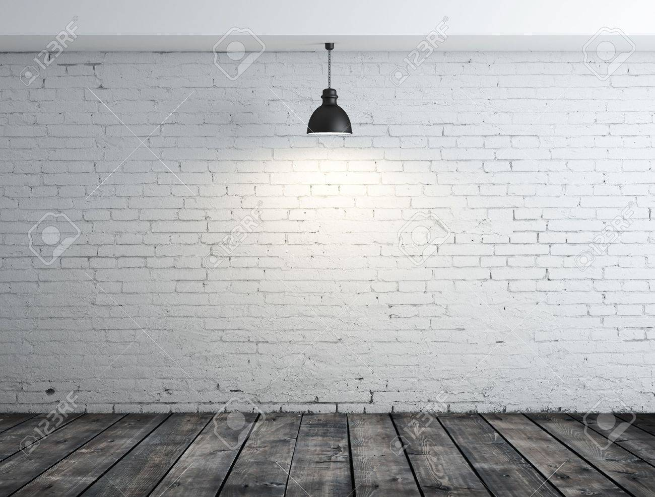 brick room with wood floor and lamp on ceiling Stock Photo - 16343341