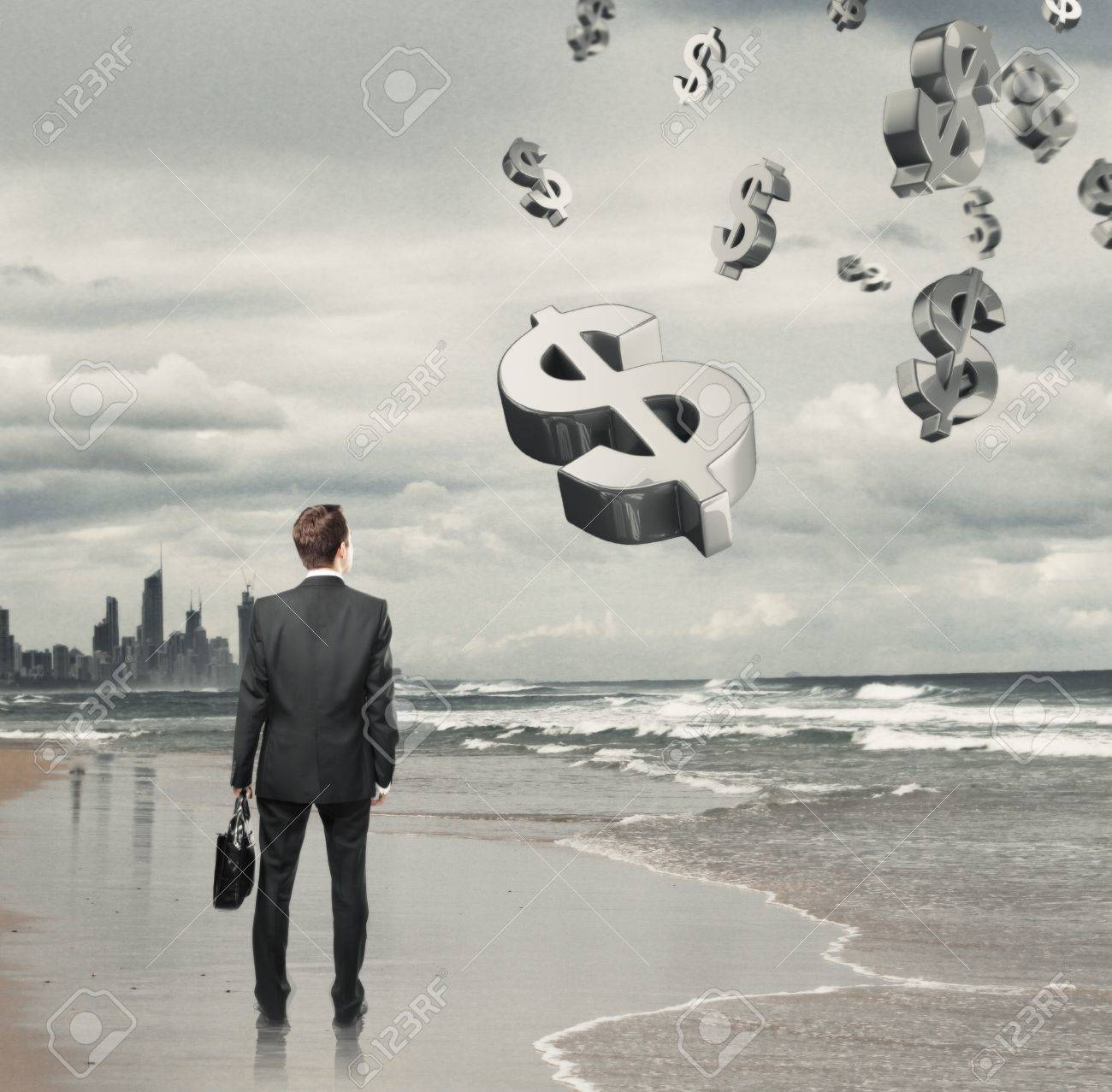 Businessman standing on a beach and  dollar symbol Stock Photo - 16985860
