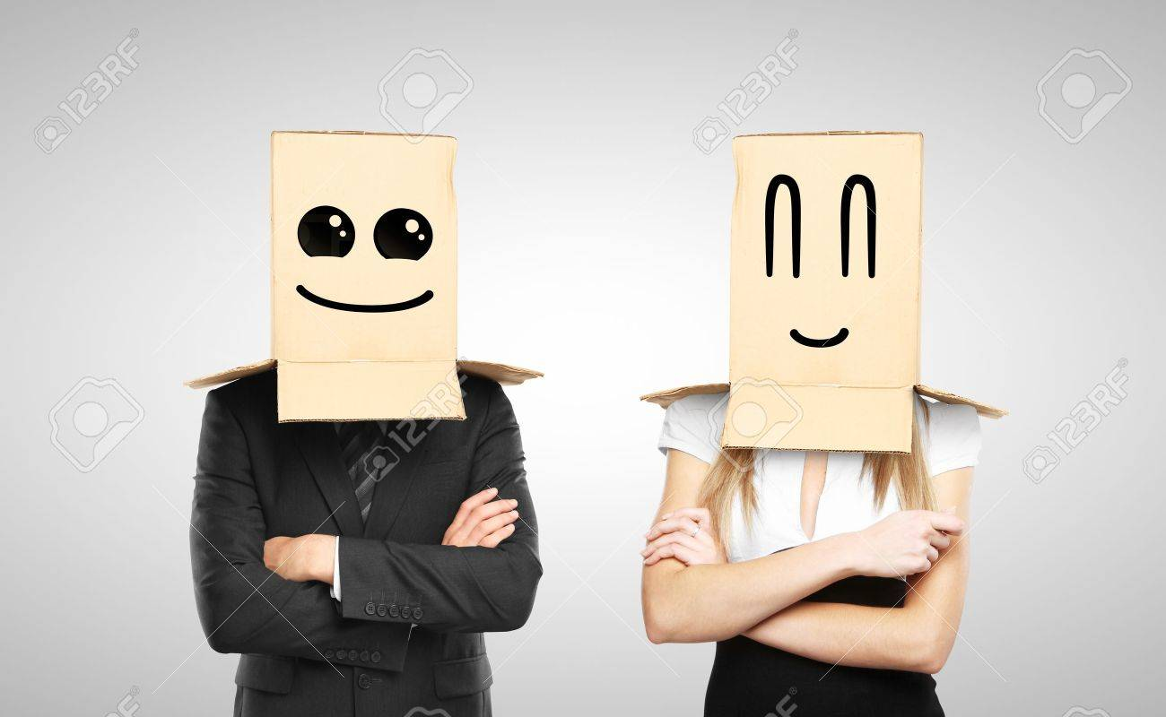 businessman and woman with smiling box on head Stock Photo - 17250380