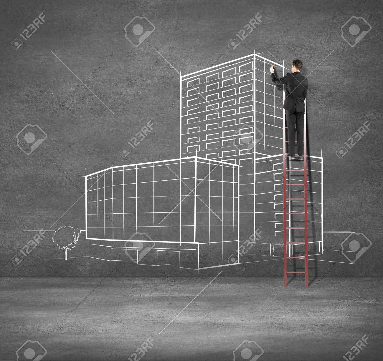 man drawing building on concrete wall Stock Photo - 18039751