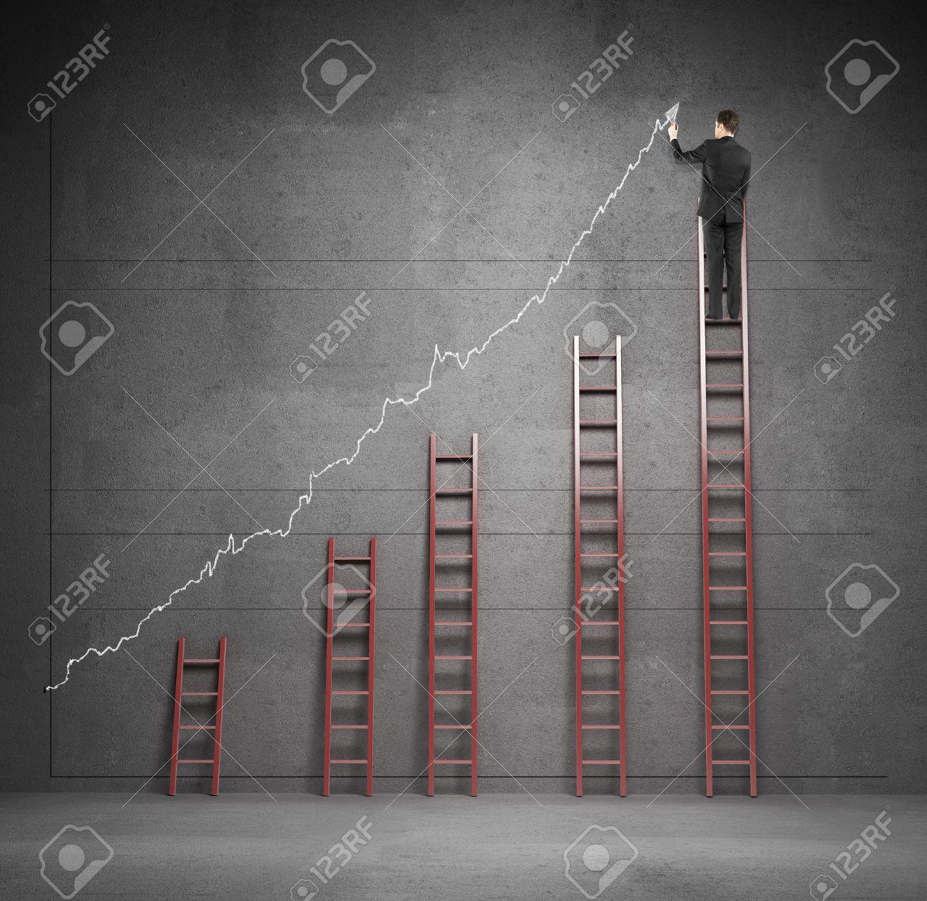 man climbing on ladder drawing graphic Stock Photo - 18039758