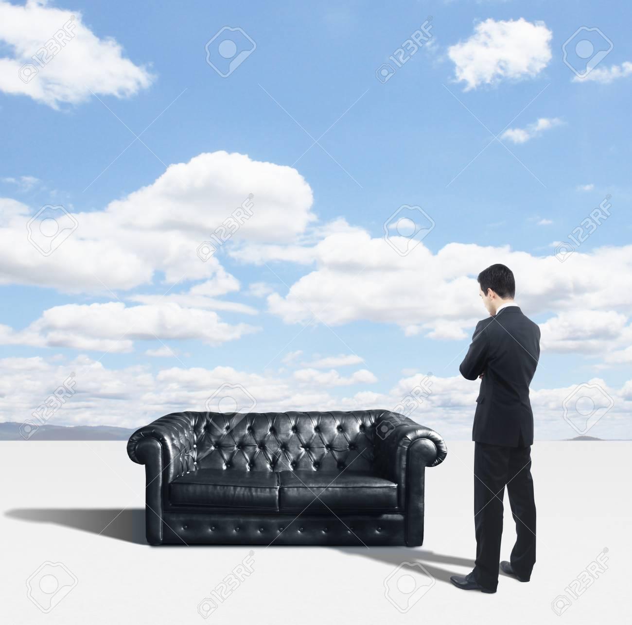 businessman looking on black sofa Stock Photo - 18039654