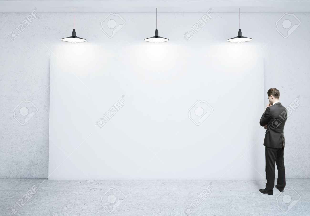 businessman looking at blank poster stock photo picture and royalty