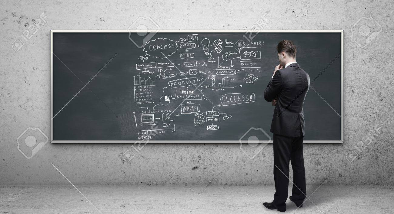 businessman looking at business strategy on blackboard Stock Photo - 18187645