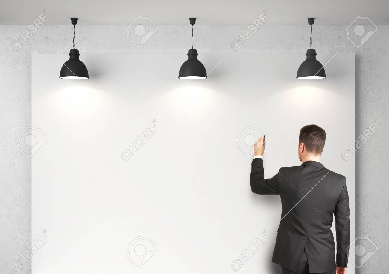 businessman drawing on blank desk Stock Photo - 18208928