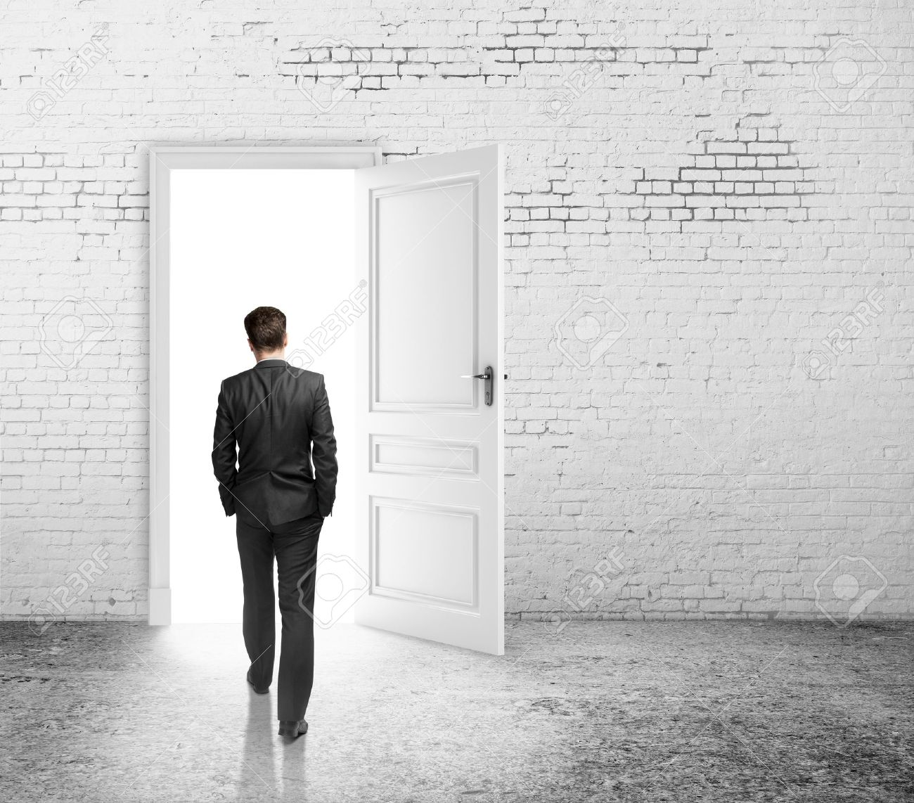 businessman walking to opened loft door Stock Photo - 18761077