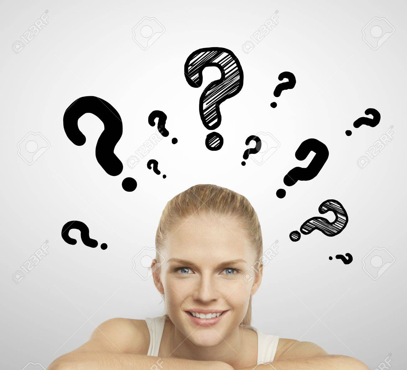 woman smiling and question mark over head Stock Photo - 19063800