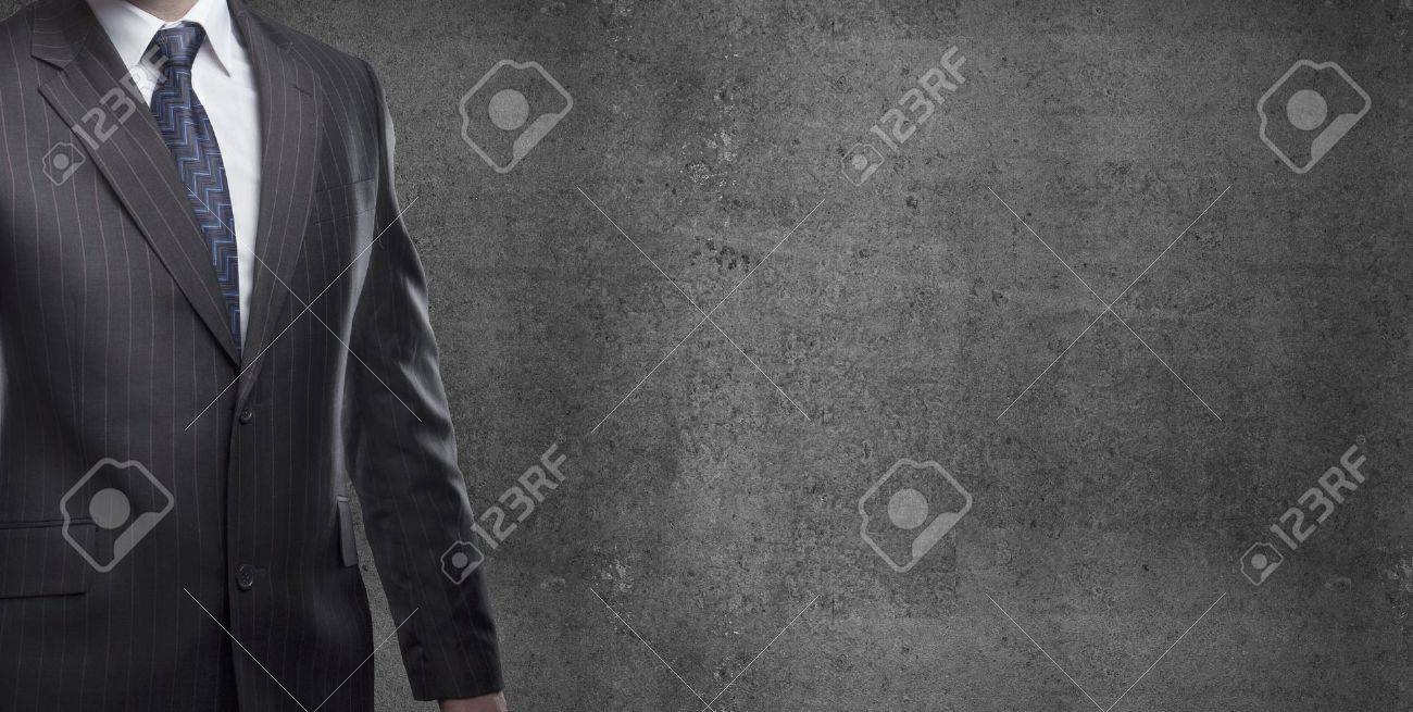 businessman in suit on a concrete background Stock Photo - 19434445