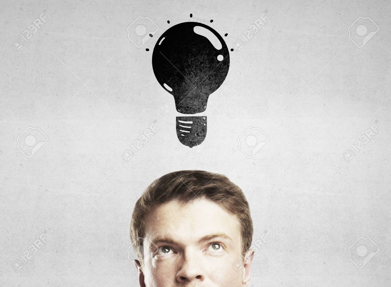 man with lamp on gray background Stock Photo - 19424252