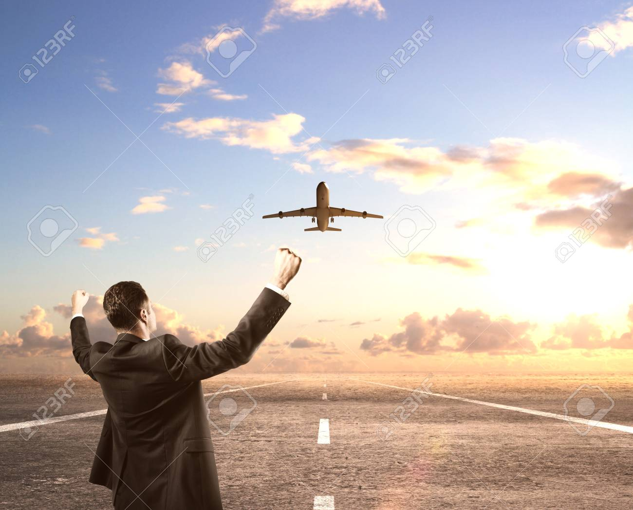 happy businessman standing on runway and looking on airplane Stock Photo - 19844438
