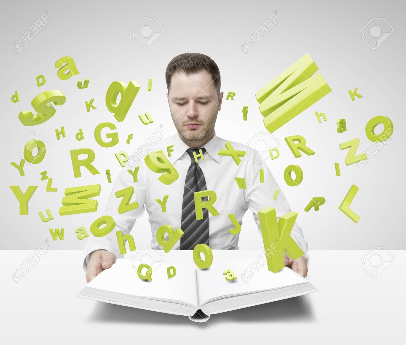 businessman holding book with many letters Stock Photo - 20339986