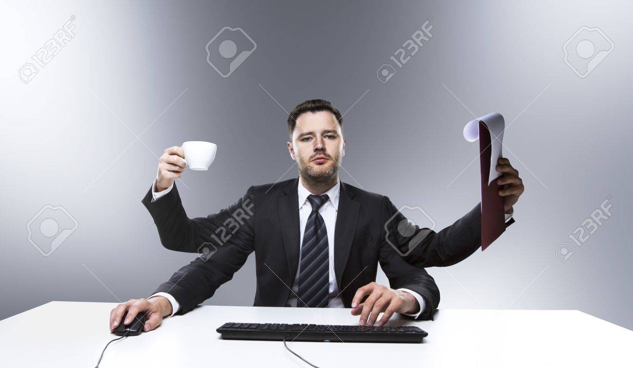 businessman with many hands on table Stock Photo - 20339989