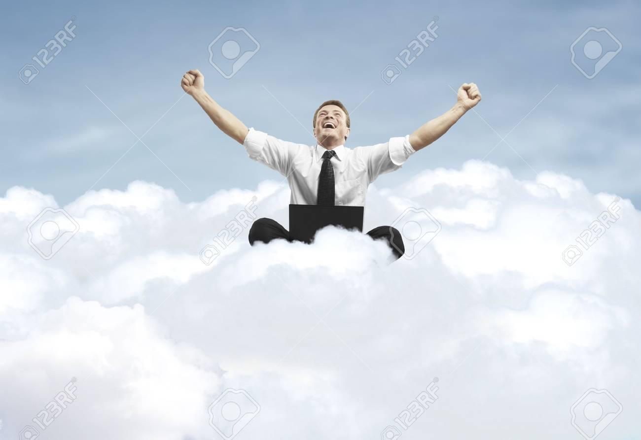 businessman admiring his success in cloud Stock Photo - 20523153