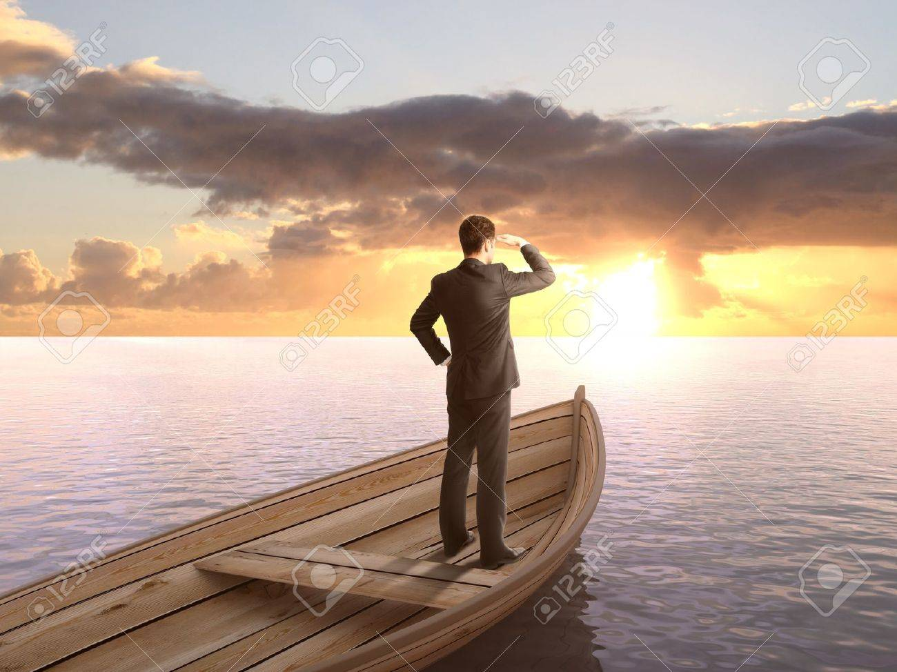 man standing on a boat and looking on sunrise Stock Photo - 20523379