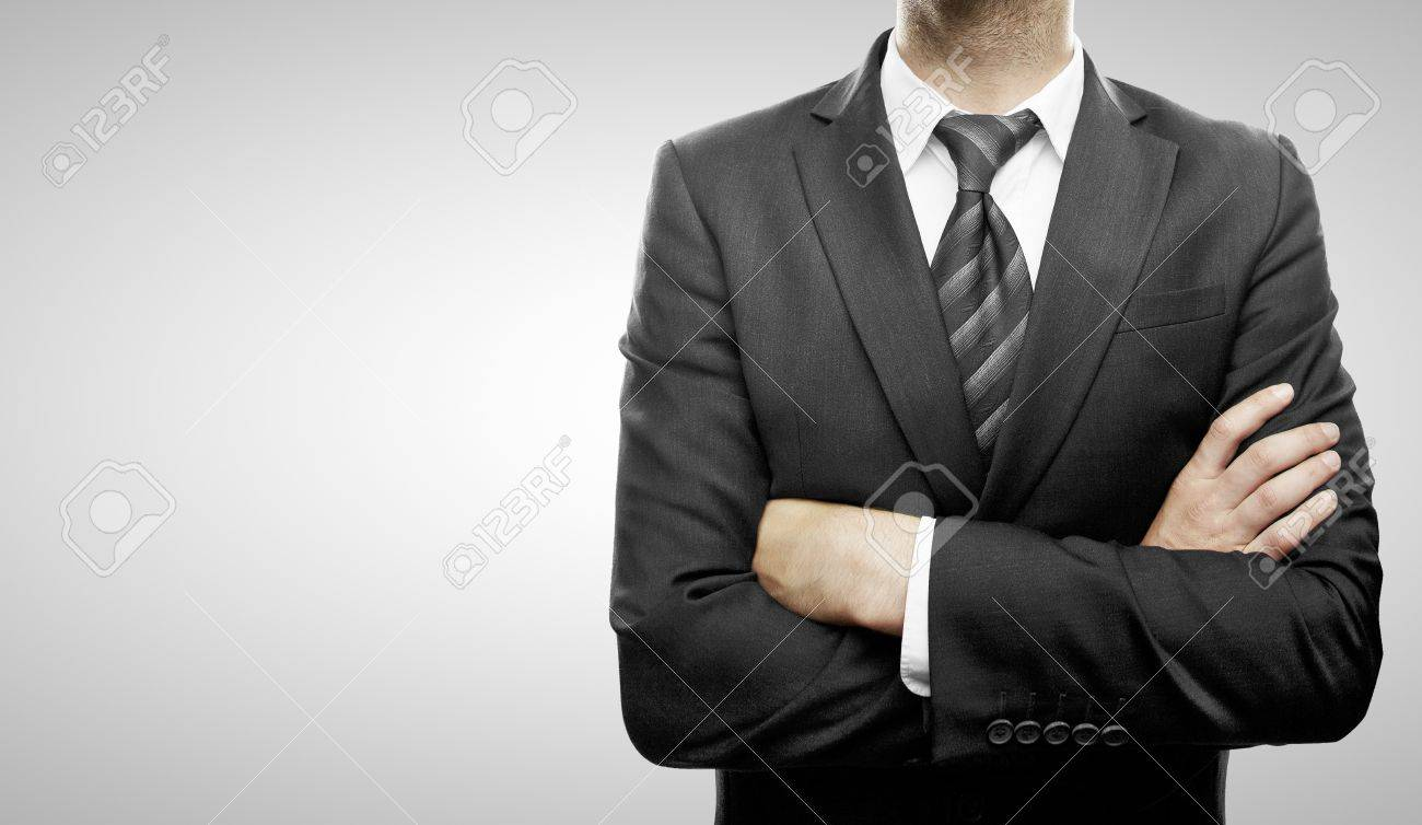young businessman standing  with hands  folded Stock Photo - 21352414