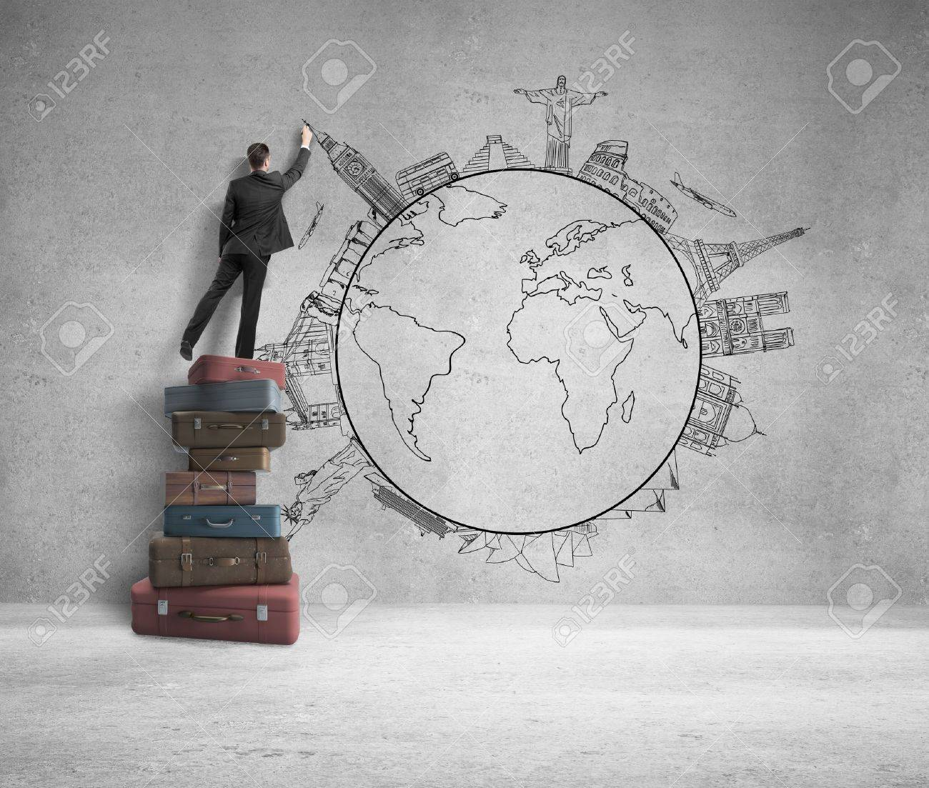 businessman standing on bags and drawing traveling concept Stock Photo - 22087730