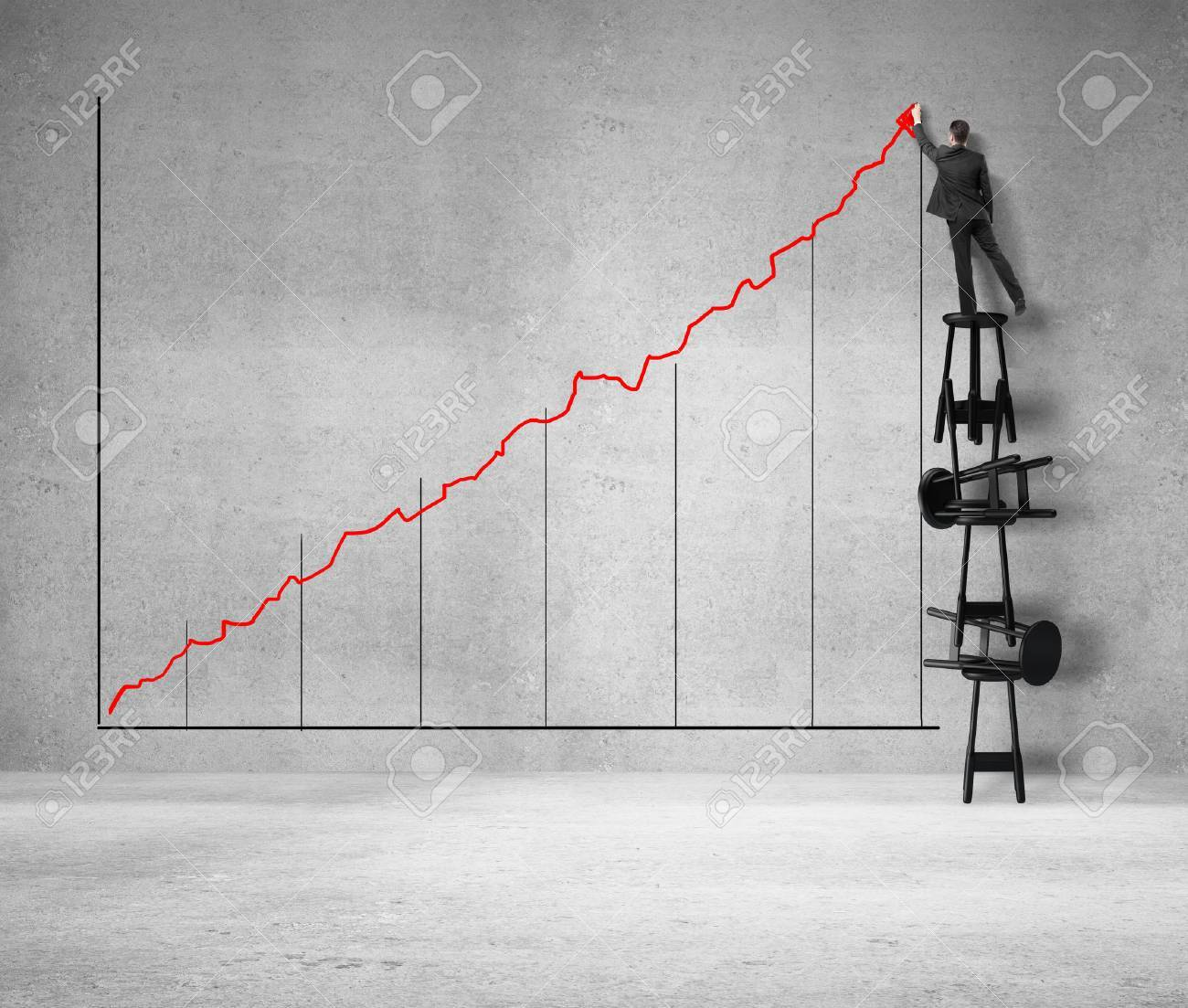 Man Standing On Stool And Drawing Graph Stock Photo, Picture And ...