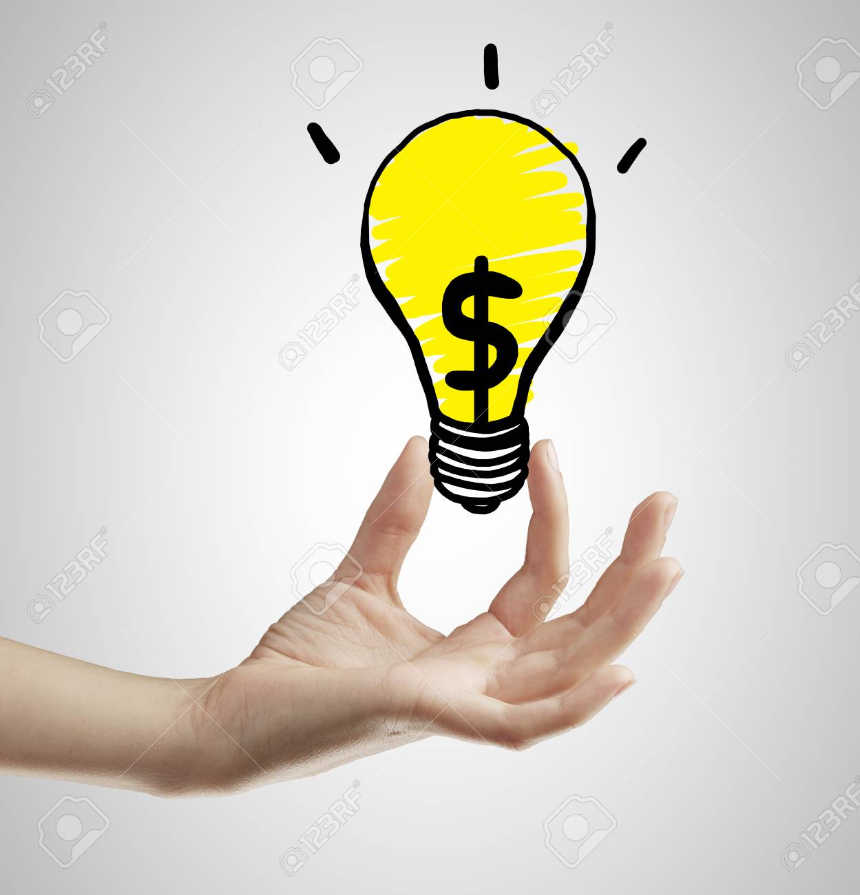 hand holding lamp with dollar sign Stock Photo - 22471069