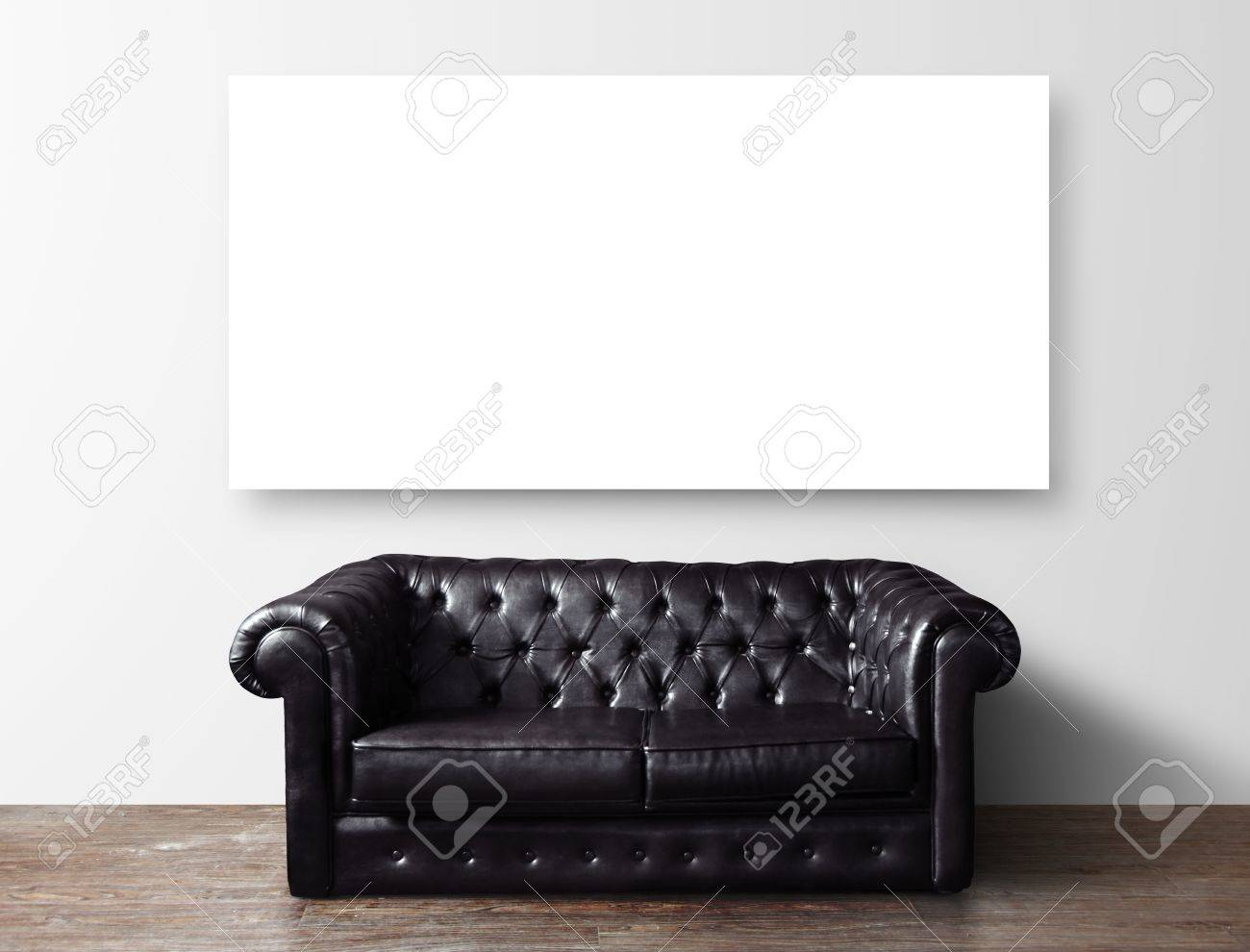 Black Leather Sofa In Room And Blank Poster On Wall Stock Photo ...