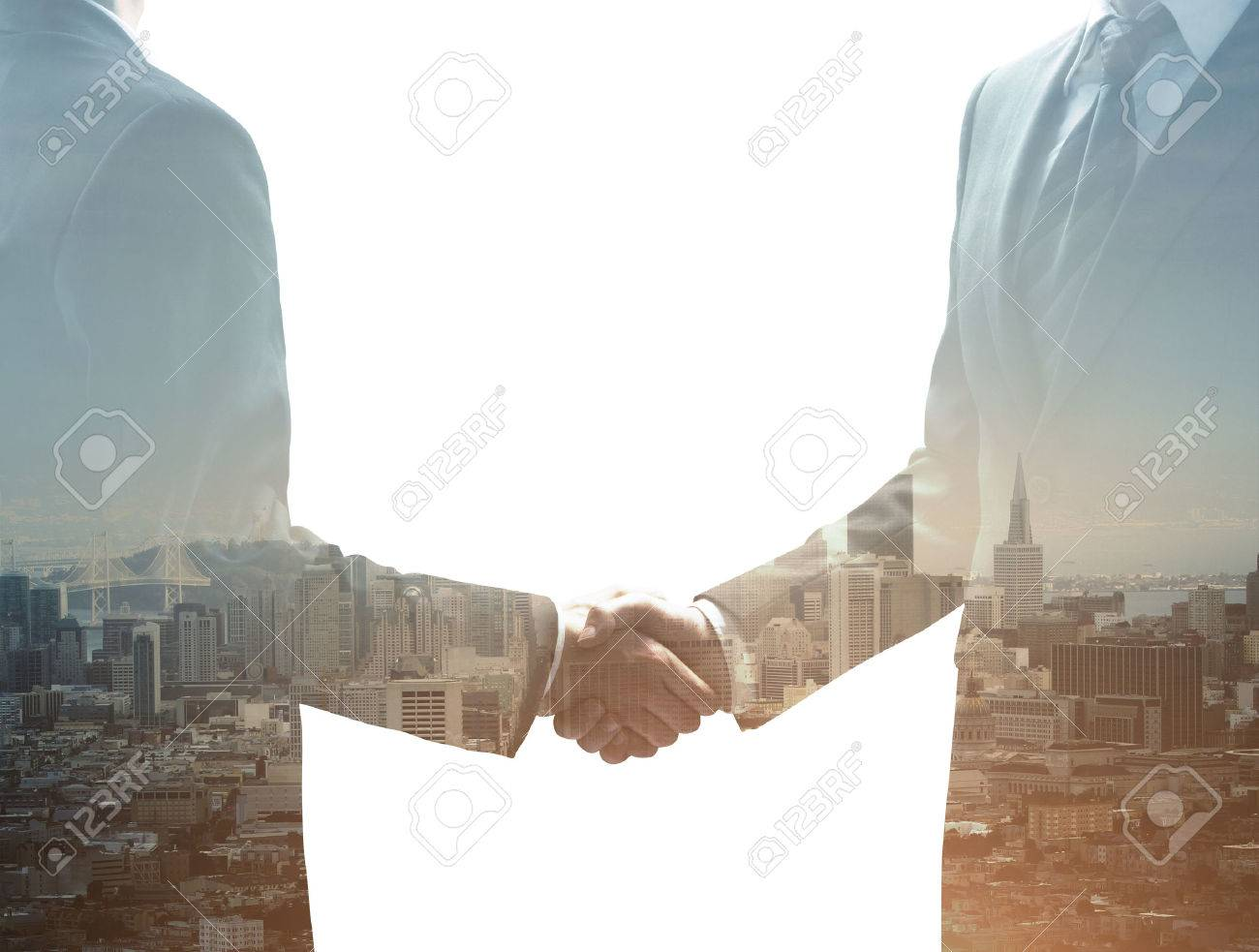 two businessmen shaking hands on city background Stock Photo - 42070794