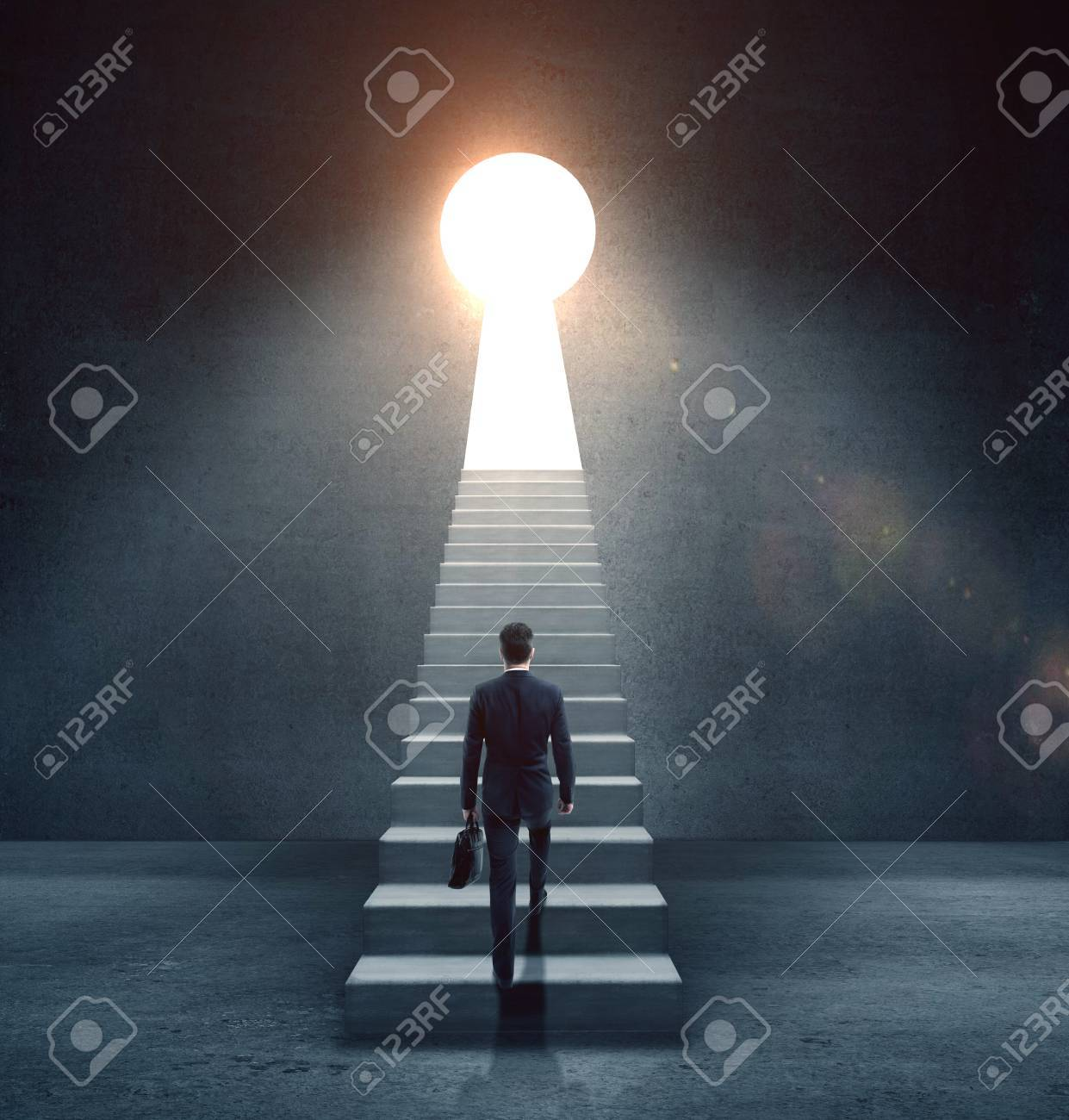 businessman climbing on concrete ledder to open door in form keyhole - 51791231