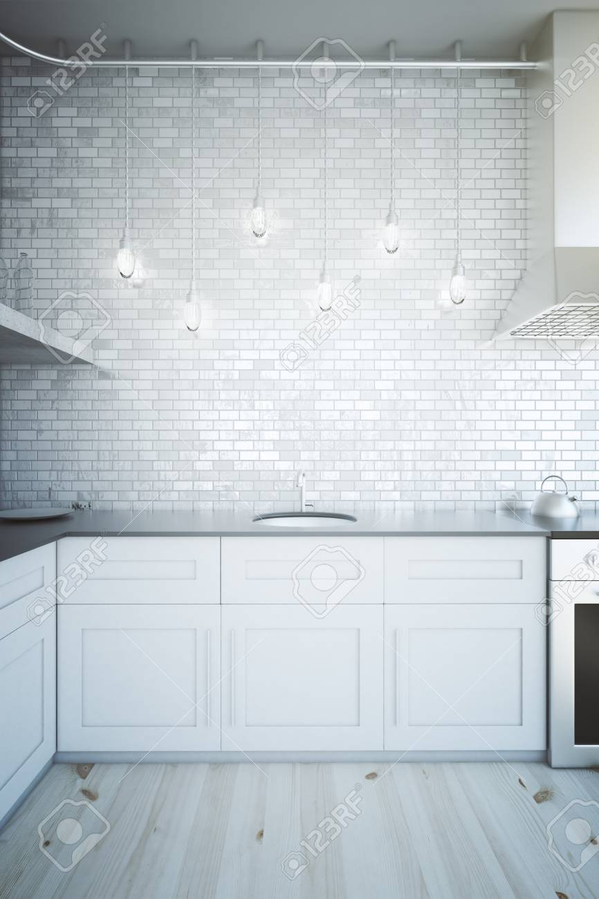 Modern white kitchen interior with brick wall illuminated by stock modern white kitchen interior with brick wall illuminated by several light bulbs 3d render stock dailygadgetfo Choice Image