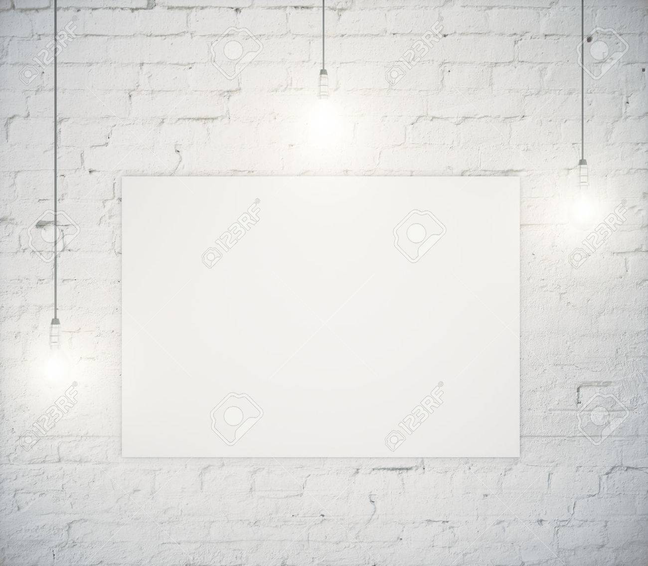 Blank poster hanging on a white brick wall with three light bulbs blank poster hanging on a white brick wall with three light bulbs mock up aloadofball Images