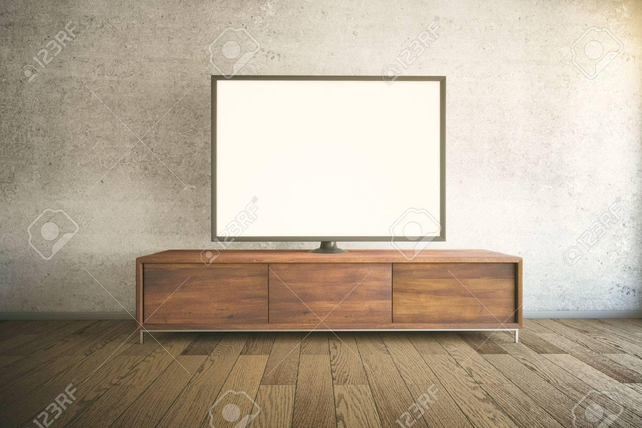 Weißer Tv Schrank dunkle holz tv-schrank mit leeren weißen tv im zimmer unter. mock-up
