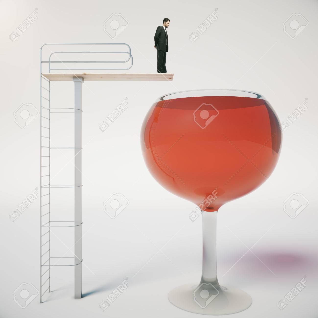 Alcool concept de dépendance avec homme d'affaires sur le point de sauter dans énorme verre de vin sur fond clair. rendu 3D