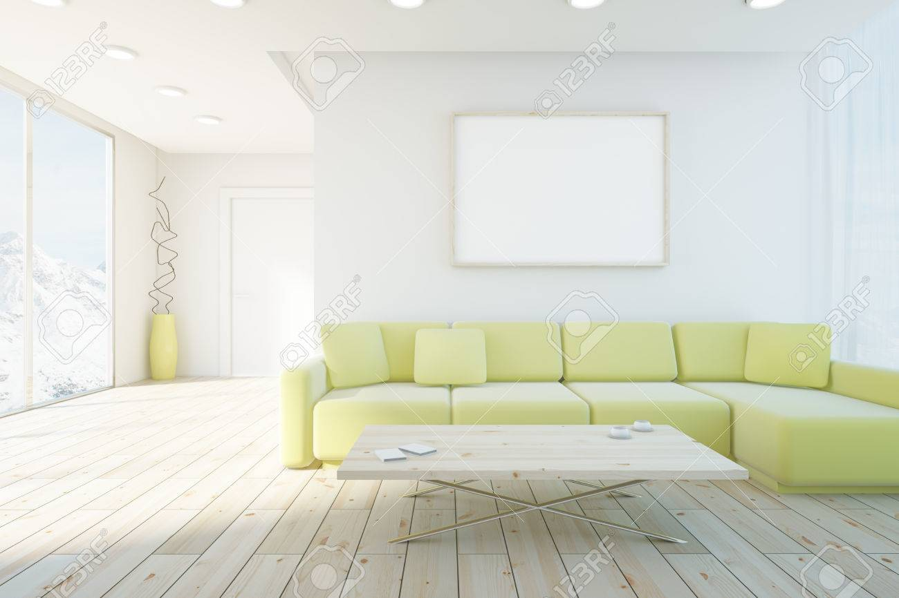 Living Room Interior With Wooden Floor, Green Couch And Blank Picture  Frame. Mock Up
